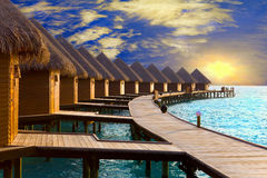 Maldives. Villa on piles on water at the time su. Nset Royalty Free Stock Image