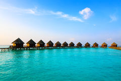 Maldives. Villa on piles on water at the time suns Stock Image