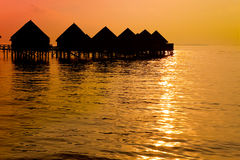 Maldives.Villa on piles on water at the time sunse Royalty Free Stock Photography
