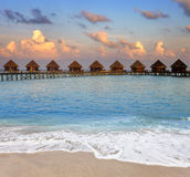 Maldives. Villa on piles on water at the time sunset Stock Photography
