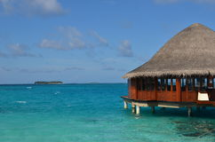 Maldives water bungalow. Scenic view of a water bungalow with blue sea in the background, Maldives Stock Photography