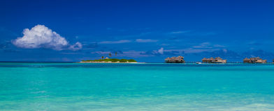 Maldives water bungalows panorama under the blue sky Royalty Free Stock Photo