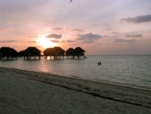Maldives water house and sunset. Water houses and sunset glow of Maldives island Stock Photo