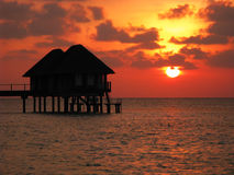 Maldives water house and sunset. Water houses and sunset glow of Maldives island Royalty Free Stock Images