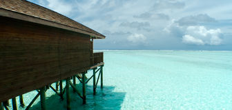 Water Villa. View of the side of a water villa in the Maldives, with a beautiful calm ocean Stock Photography