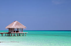 Maldives. Water villa Maldives in blue water royalty free stock images