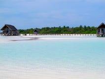 Maldives water villa and white beach Stock Image