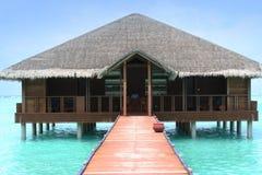 Maldives waterhouse. Medhufushi Island Resort is naturally quiet, serene, authentic Maldivian island with SPA salon royalty free stock images
