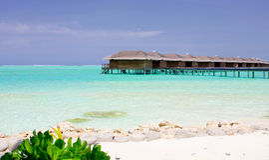 Maldives waterhouse. Medhufushi Island Resort is naturally quiet, serene, authentic Maldivian island with SPA salon stock photos