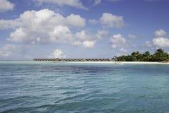 Maldives Waterhuts and Beach. Maldives Beach Resort in South Ari Atoll Royalty Free Stock Images