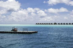 Maldives Waterplane Jetty. View on the waterplane jetty and the waterbungalows at White Sands Island Royalty Free Stock Photography
