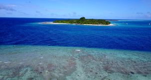 V11462 maldives white sand beach tropical islands with drone aerial flying birds eye view with aqua blue sea water and Stock Photos