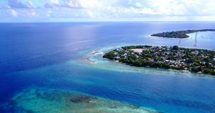 V13447 maldives white sand beach tropical islands with drone aerial flying birds eye view with aqua blue sea water and Stock Images