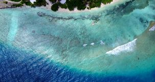 V11433 maldives white sand beach tropical islands with drone aerial flying birds eye view with aqua blue sea water and Royalty Free Stock Photography
