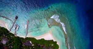 V14741 maldives white sand beach tropical islands with drone aerial flying birds eye view with aqua blue sea water and Stock Image