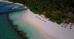 V15260 maldives white sand beach tropical islands with drone aerial flying birds eye view with aqua blue sea water and Stock Photo