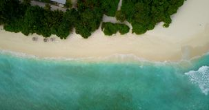 V14638 maldives white sand beach tropical islands with drone aerial flying birds eye view with aqua blue sea water and Royalty Free Stock Photos
