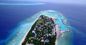 V11504 maldives white sand beach tropical islands with drone aerial flying birds eye view with aqua blue sea water and Royalty Free Stock Photos