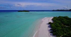 V14723 maldives white sand beach tropical islands with drone aerial flying birds eye view with aqua blue sea water and Stock Photos