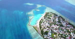 V11476 maldives white sand beach tropical islands with drone aerial flying birds eye view with aqua blue sea water and Stock Photo