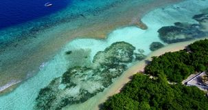 V15440 maldives white sand beach tropical islands with drone aerial flying birds eye view with aqua blue sea water and Royalty Free Stock Photography