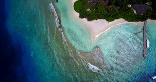 V11384 maldives white sand beach tropical islands with drone aerial flying birds eye view with aqua blue sea water and Stock Image