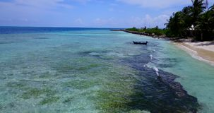 V14627 maldives white sand beach tropical islands with drone aerial flying birds eye view with aqua blue sea water and Stock Image