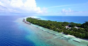V10335 maldives white sand beach tropical islands with drone aerial flying view with aqua blue sea water and sunny sky Royalty Free Stock Photography
