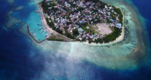 V10554 maldives white sand beach tropical islands with drone aerial flying view with aqua blue sea water and sunny sky Royalty Free Stock Image