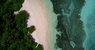 V10644 maldives white sand beach tropical islands with drone aerial flying view with aqua blue sea water and sunny sky Stock Images