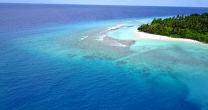 V10495 maldives white sand beach tropical islands with drone aerial flying view with aqua blue sea water and sunny sky Stock Images