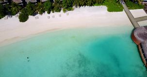 V10527 maldives white sand beach tropical islands with drone aerial flying view with aqua blue sea water and sunny sky Royalty Free Stock Image