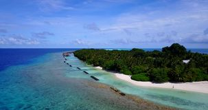 V10392 maldives white sand beach tropical islands with drone aerial flying view with aqua blue sea water and sunny sky Stock Photography