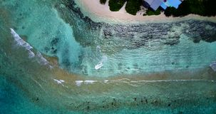 V10426 maldives white sand beach tropical islands with drone aerial flying view with aqua blue sea water and sunny sky Stock Image