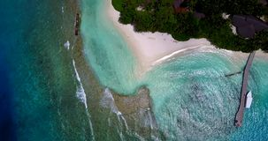 V10518 maldives white sand beach tropical islands with drone aerial flying view with aqua blue sea water and sunny sky Royalty Free Stock Photo