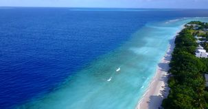 V10565 maldives white sand beach tropical islands with drone aerial flying view with aqua blue sea water and sunny sky Stock Image