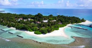 V10307 maldives white sand beach tropical islands with drone aerial flying view with aqua blue sea water and sunny sky Stock Photos