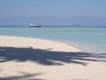 Maldives. White sand and boat in Maldives Stock Photos