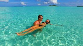 P02962 Maldives white sandy beach 2 people a young couple man woman romantic love on sunny tropical paradise island with Royalty Free Stock Photos