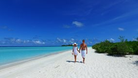 P02956 Maldives white sandy beach 2 people a young couple man woman romantic love on sunny tropical paradise island with Royalty Free Stock Photography