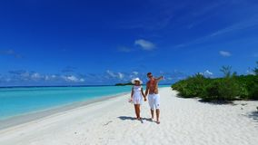 P02948 Maldives white sandy beach 2 people a young couple man woman romantic love on sunny tropical paradise island with Royalty Free Stock Photography