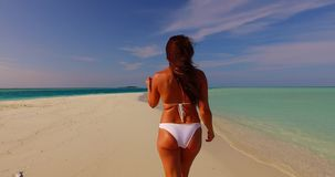 Maldives white sandy beach 1 person young beautiful lady sunbathing alone on sandbar on sunny tropical paradise