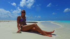 P02722 Maldives white sandy beach 1 person young beautiful woman relaxing on sunny tropical paradise island with aqua Stock Photography