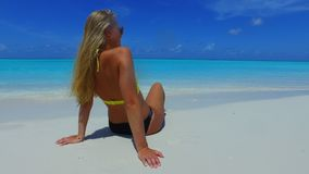P02724 Maldives white sandy beach 1 person young beautiful woman relaxing on sunny tropical paradise island with aqua Royalty Free Stock Images