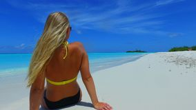 P02721 Maldives white sandy beach 1 person young beautiful woman relaxing on sunny tropical paradise island with aqua Royalty Free Stock Photo