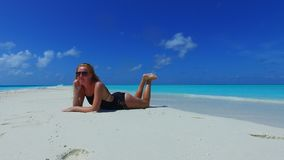 P02711 Maldives white sandy beach 1 person young beautiful woman relaxing on sunny tropical paradise island with aqua Royalty Free Stock Photos
