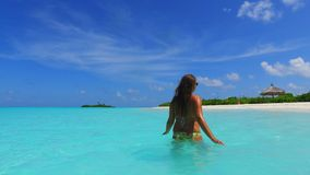 P02738 Maldives white sandy beach 1 person young beautiful woman relaxing on sunny tropical paradise island with aqua Royalty Free Stock Image