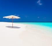Maldives,  white sunbed and parasol Royalty Free Stock Image