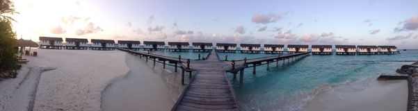 Maldives wide lense shot of water villas royalty free stock image