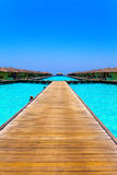 Maldives. A wooden road over ocean Royalty Free Stock Photography